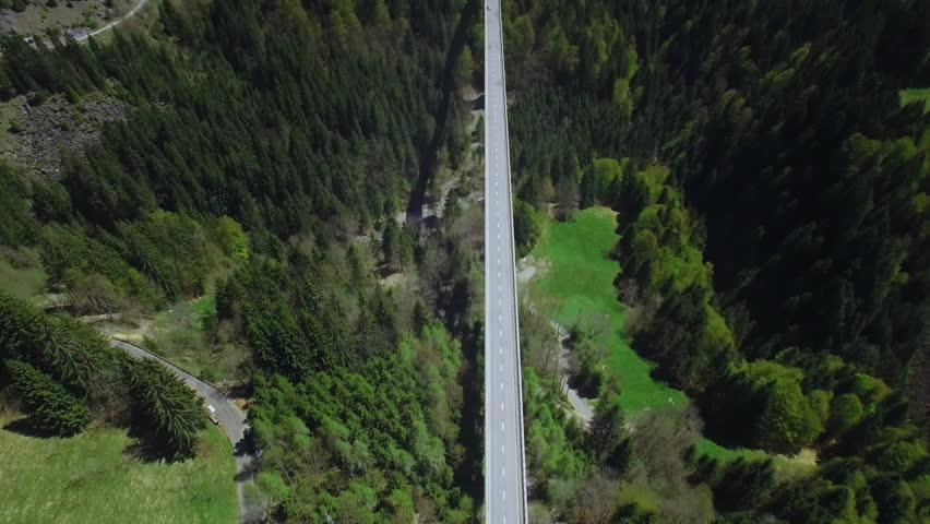 4K peaceful still aerial view of a car crossing a bridge / High altitude cinematic shot #16835686