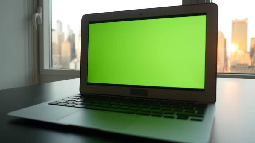 Laptop computer with isolated green screen background. modern city office desk view. working at home. green chroma key background | Shutterstock HD Video #16836046
