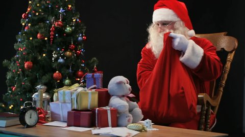 Santa putting wrapped presents into his sack