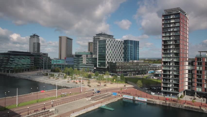 Elevated footage of a pan of new apartments and the new Mediacity development in Salford Quays, Manchester