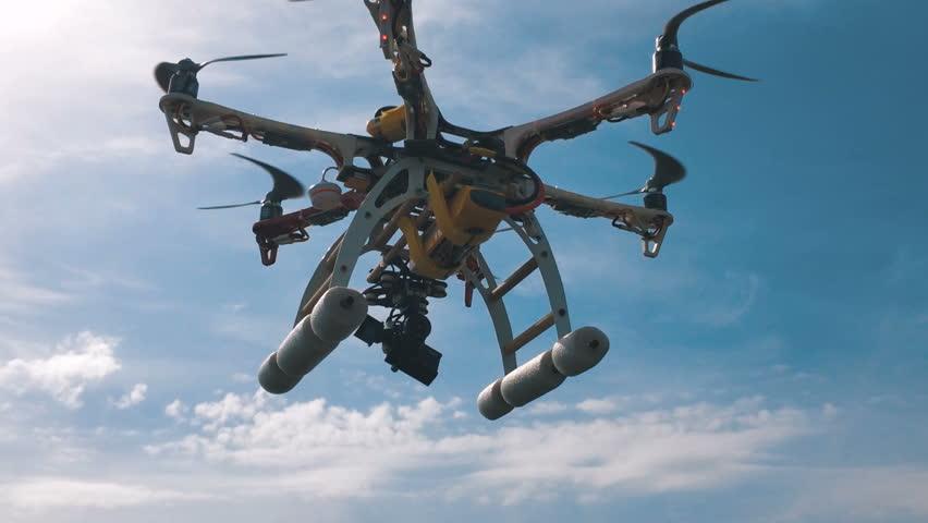 Custom hexacopter drone flies in the sky