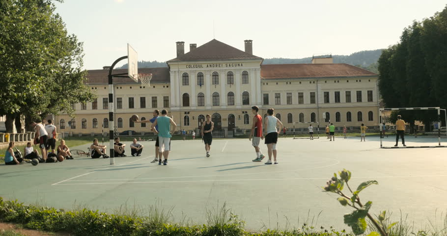 BRASOV, ROMANIA - CIRCA 2015: High school basketball team playing in the yard of the Colegiul Andrei Saguna in the heart of Brasov, Romania, timelapse, fast motion