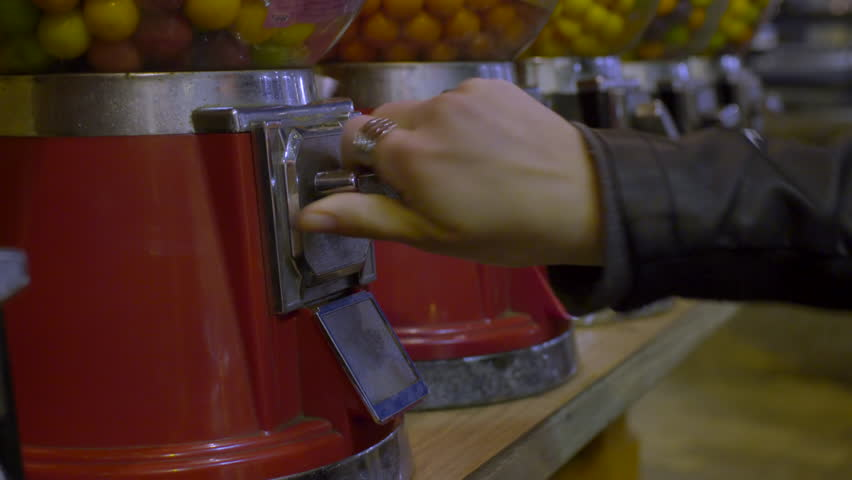 Closeup Of Teen's Hand As She Pays For A Gumball