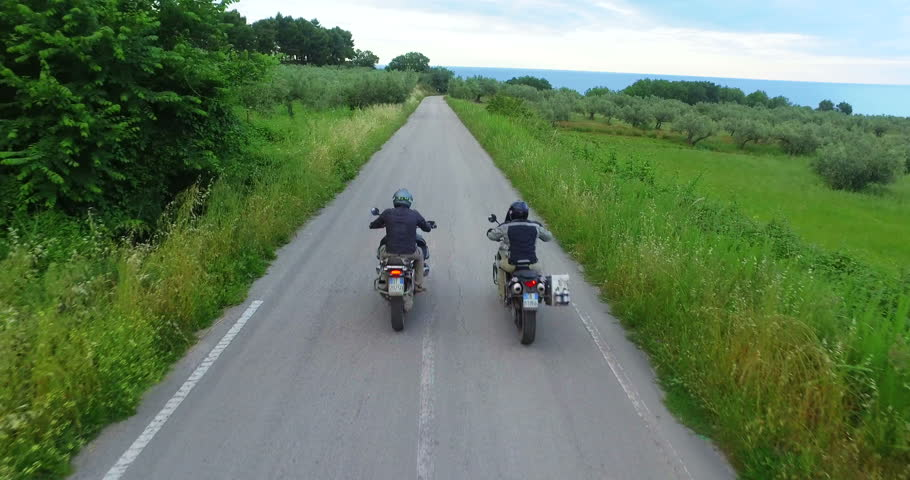 Italy, hills of tuscany, camera car of Two motorcyclists on mountain highway having fun and enjoying road, no logos shot NO LOGOS