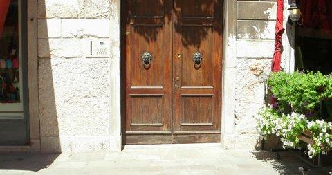 Old door to balcony pan. Ancient door. Ancient gate. Old door. Door frame. Ancient door Italy. Italian ancient door. Old door frame. Balcony. Balcony flower. Balcony door. Balcony window. Door balcony