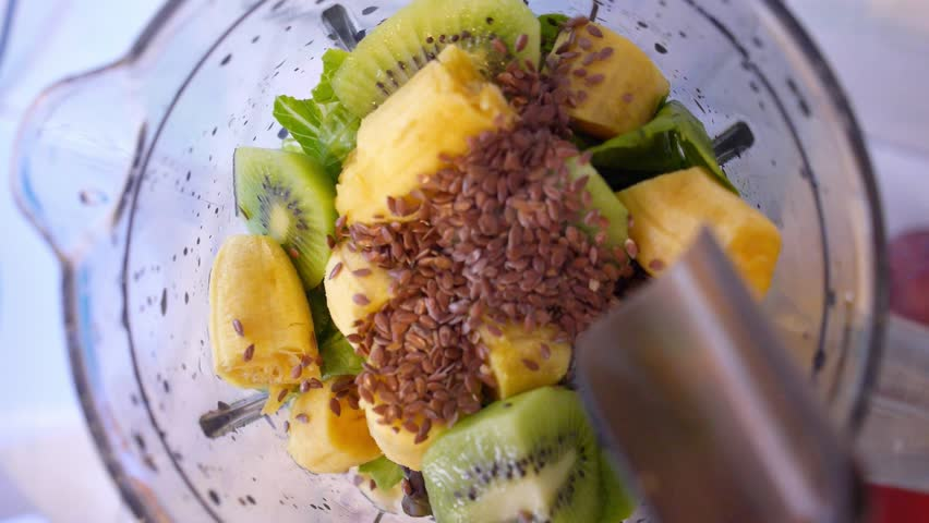 Pouring Flax Seeds in Fruit Smoothie in Blender. Healthy Concept