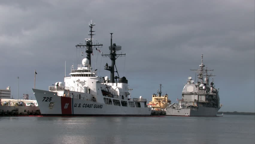 Pearl Harbor Coast Guard and Navy ship. Honolulu, Hawaii. Coast Guard Cutter Jarvis and Navy Aegis Class Cruiser in port. Ships in dock from Navy and Coast Guard.