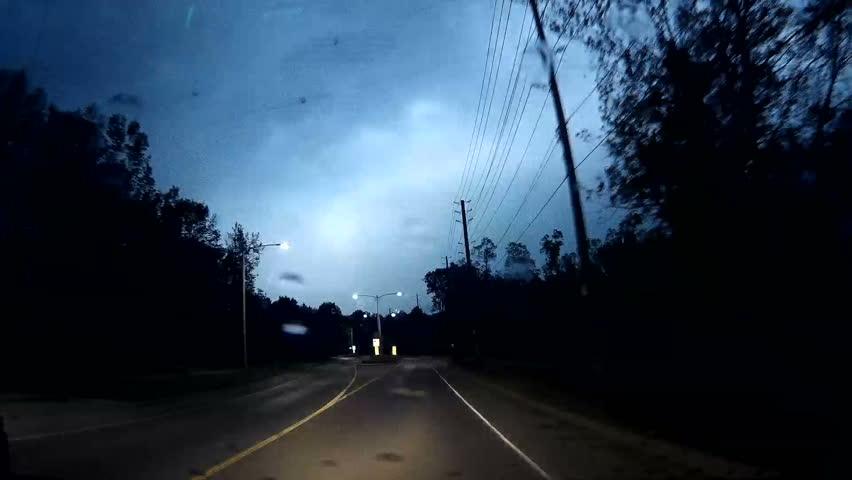 Waterloo, Ontario, Canada May 2016 POV dashcam driving on dark rainy night in lightning storm