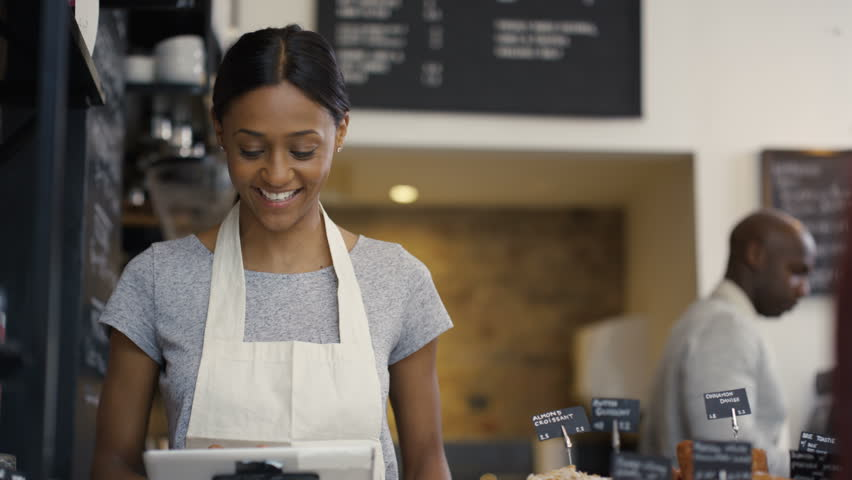 4K Cheerful worker serving a customer who uses smartphone to pay in coffee shop. UK - April, 2016 | Shutterstock HD Video #17023276