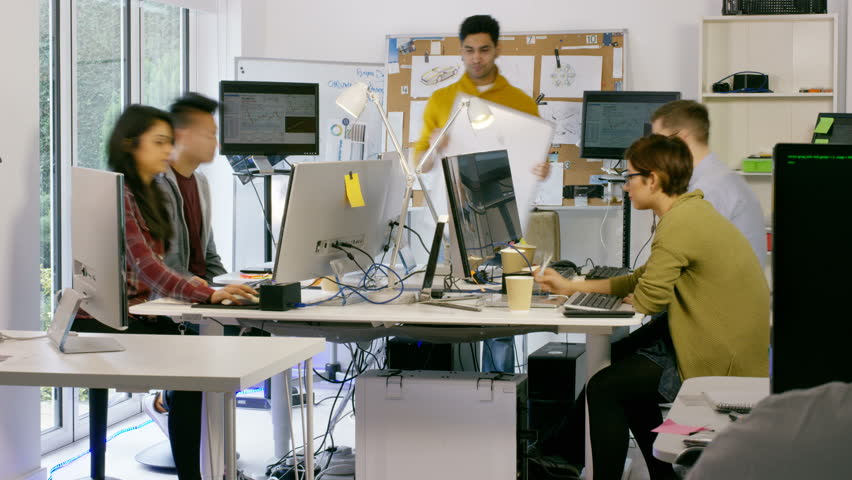 4K Time lapse of young computer experts working in office with lots of computers. Shot on RED Epic. UK - April, 2016 | Shutterstock HD Video #17049706