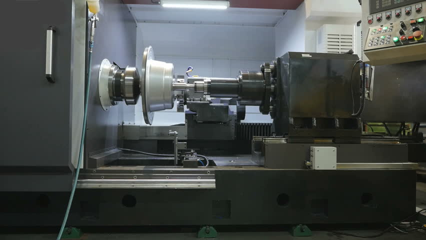 Metal Spinning machine shaping a peace of metal   Shutterstock HD Video #17051236