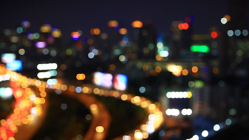 Night time in the city. Out of focus with blurry. unfocused city lights. traffic bokeh.  city noise. Bangkok. Thailand.