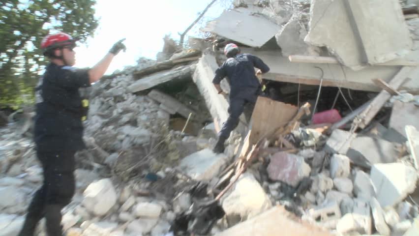 PORT-AU PRINCE, HAITI - CIRCA 2010: rescue units around destroyed building circa 2010 in Haiti.
