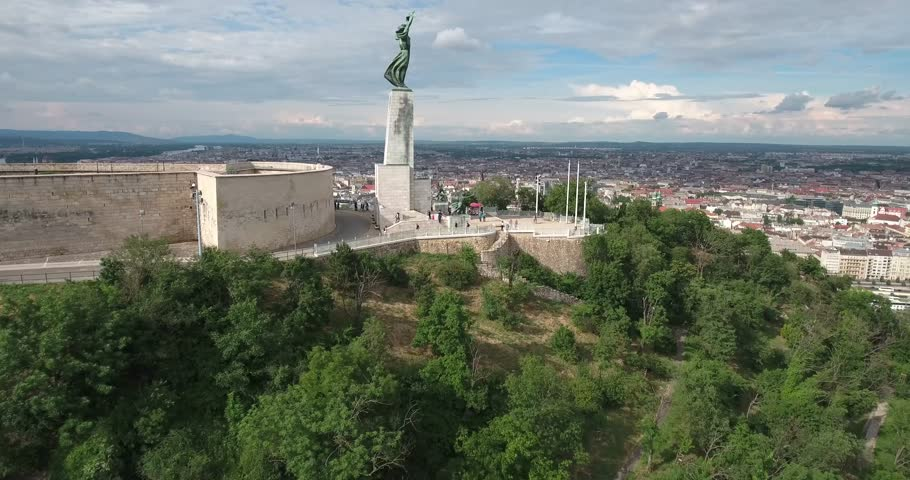 Aerial footage from a drone shows the Liberty Statue or Freedom Statue in Budapest, Hungary