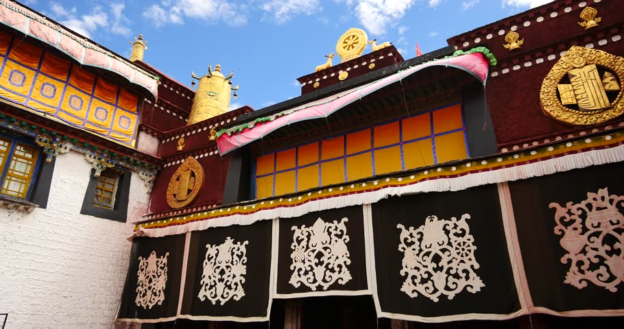 4k closeup of The Jokhang Temple In Lhasa,Tibet,white clouds in blue sky. gh2_09631_4k