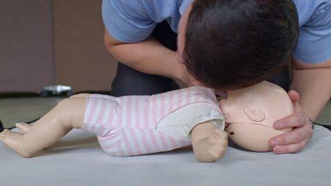 First aid cardiopulmonary resuscitation training on toddler manikin
