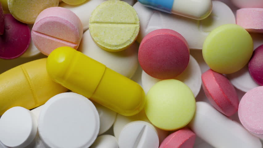 Medicine And Drugs. Many pills tablets and capsules turning. | Shutterstock HD Video #17097796