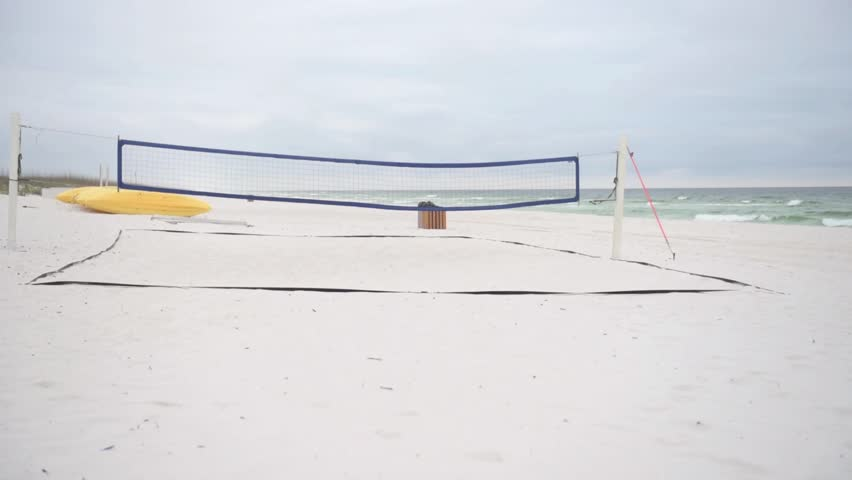 Empty Volleyball field in Pensacola Beach, Gulf of Mexico in background.
