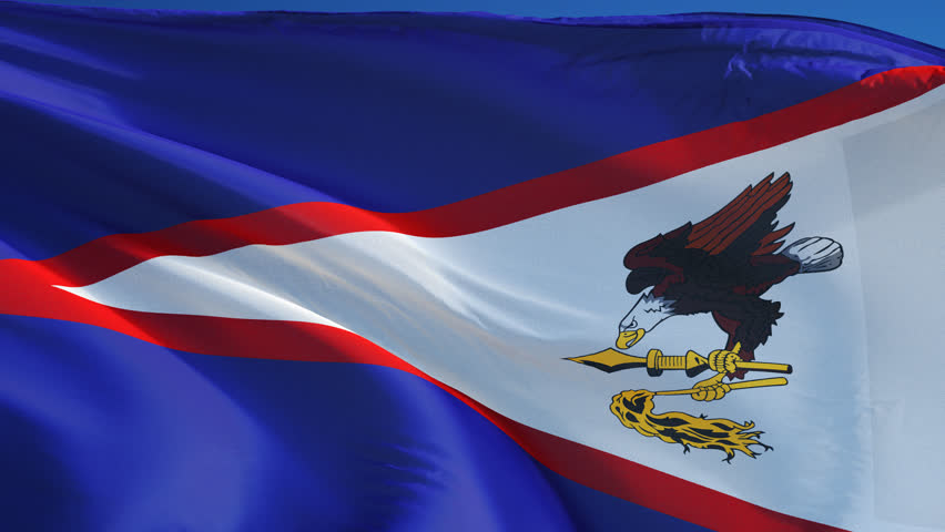 American Samoa flag waving in slow motion against blue sky, seamlessly  looped, close up