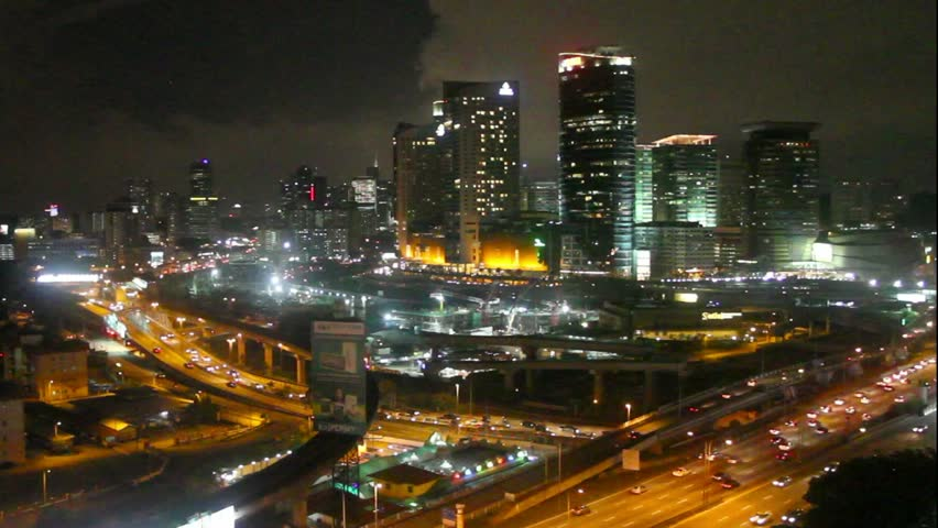 KUALA LUMPUR, MALAYSIA - JUN 17, 2015: Night view at Mid Valley Megamall commercial area in Bangsar, Kuala Lumpur with traffic flow.  | Shutterstock HD Video #17170516