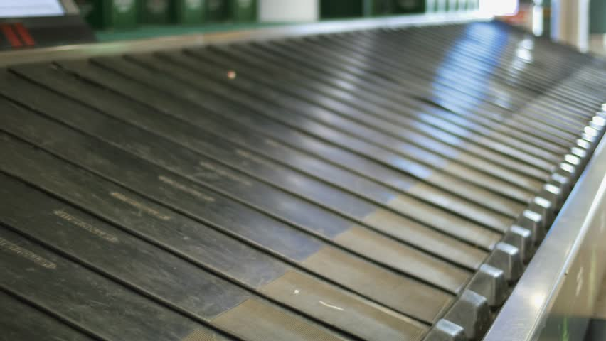 Empty modern luggage belt in the airport, baggage claim conveyor | Shutterstock HD Video #17186236