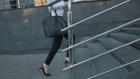 Businesswoman Legs In High-Heeled Shoes Walking Up Stairs On Stairway. Sexy Woman near Office after Work. Student girl go to lessons.