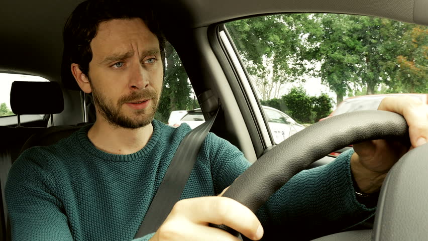 Sad Handsome Man Almost Crying Driving Car Thinking About Lost Love 4K  Closeup   4K Stock
