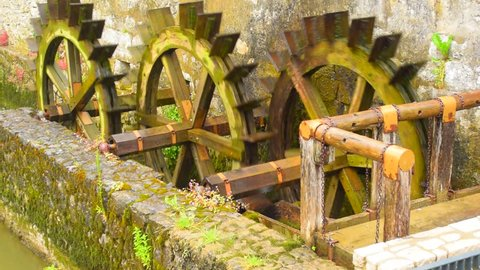 Old water mill. Water wheel of old mill in the Postojna Caves, Slovenia. Rotate wooden wheel of the old water mill.