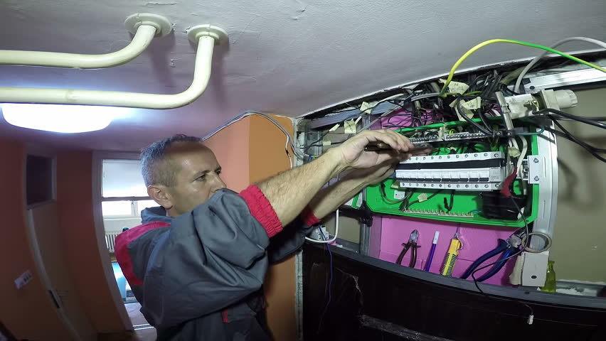 1 electrician working on the automatic circuit breakers with General Electric Fuse Box at bakdesigns.co