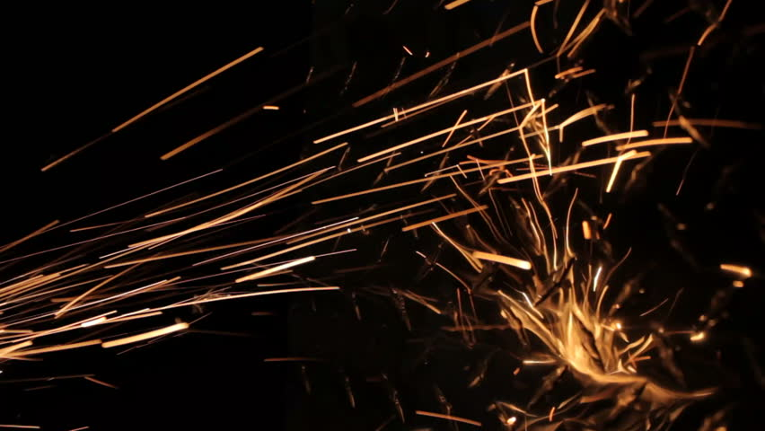 Sparks fly and hit a metal diamond plate background