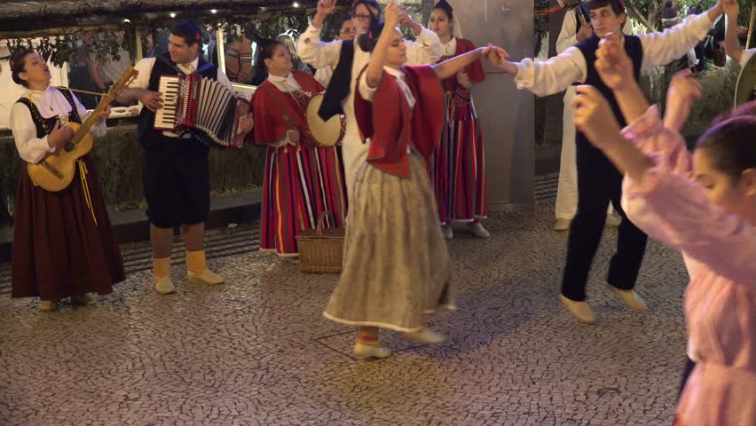 Madeira, Funchal, 1 Jan. 2015, 4k UHD Traditional cultural Madeira dance music street event Funchal city at night with christmas decoration /  Traditional Madeira dance and music street night event