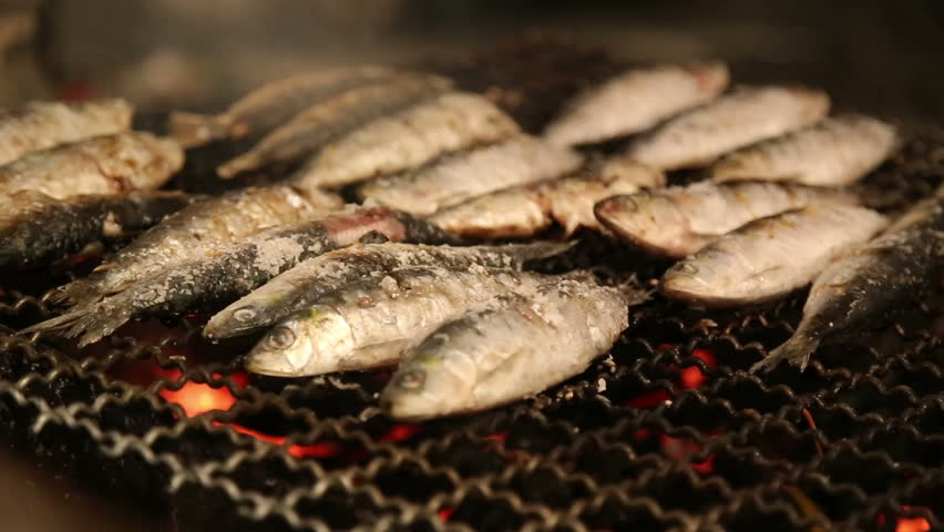 LISBON - JUNE 12,2016: Grilled sardines on the fire