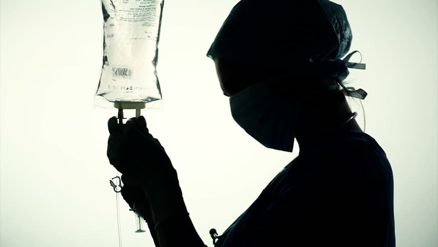 silhouette of nurse injecting medicine in infusion
