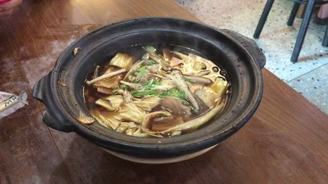 Bak kut teh named of traditional chinese pork soup in hot bowl.