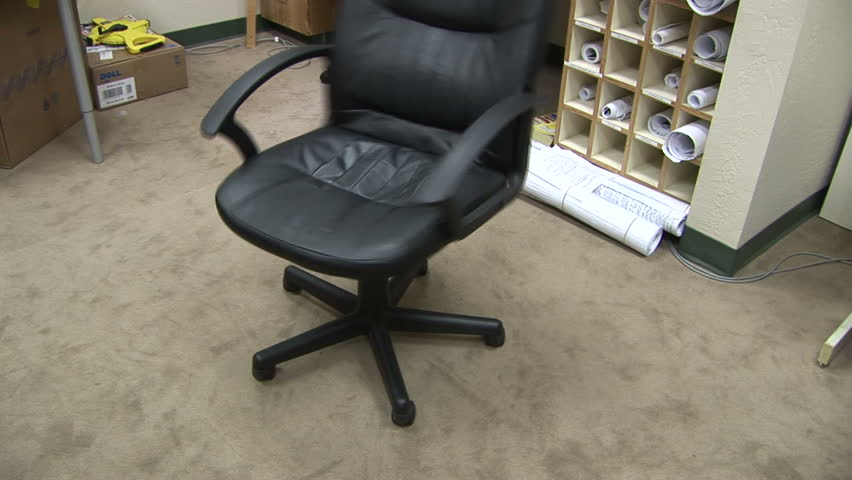 Bon Empty Leather Chair Spinning In An Office In Scottsdale Arizona