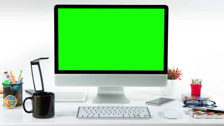 Computer desk with colorful office elements. Lateral dolly. Chroma Key. Perfect to put your own images or videos. Track with perspective corner pin.