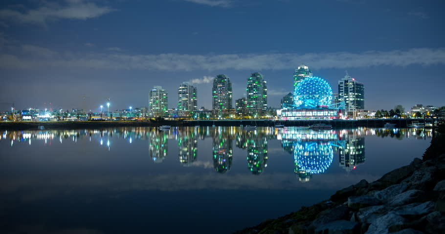 Vancouver, British Columbia, Canada - view over False Creek of illuminated Science World in Creekside Park at night - Timelapse without motion