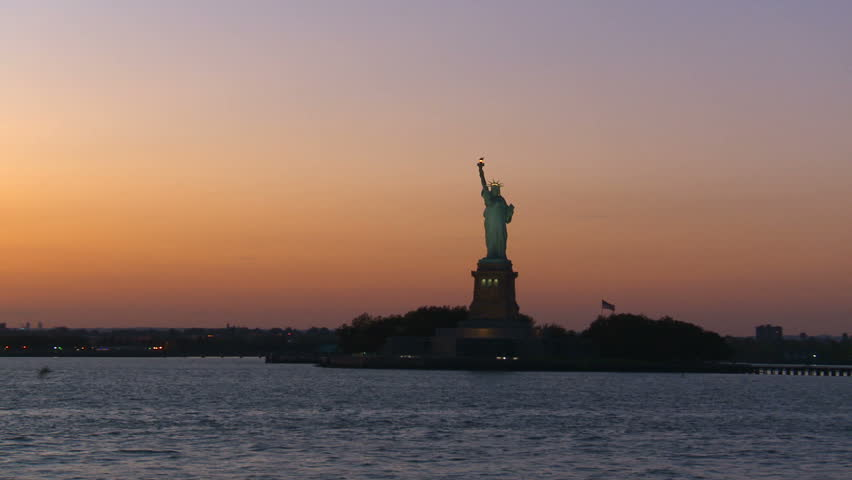 NEW YORK, NY - CIRCA 2010: The Statue of Liberty at dusk in New York Harbor | Shutterstock HD Video #1746766