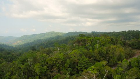 Costa Rica Aerial v15 Flying low over dense jungle forests panning to large bay views.