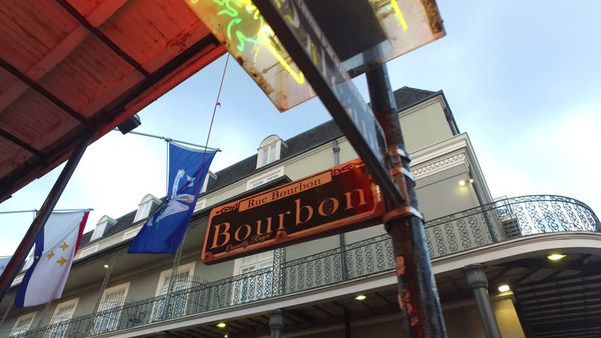 New Orleans Bourbon Street sign. Could be used to show Bourbon Street, Mardi Gras, party, carnival, parade, night out, bachelor party or investigative drama involving Bourbon Street. | Shutterstock HD Video #17487004