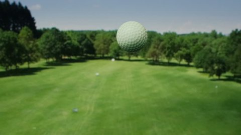Aerial view of the golf ball. Shot in super slow motion.