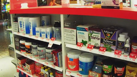 Beverly hills ca/usa: june 1, 2016- muscle building supplements at health  and nutrition store  boxes and containers are stacked neatly on shelves at  a retail store that sells vitamins and supplements