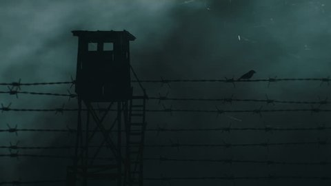 Barbed wire remains of iron curtain. Sparrow and watchtower.