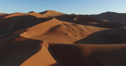 4K aerial view of endless sand dunes of the Namib desert inside the Namib-Naukluft National Park
