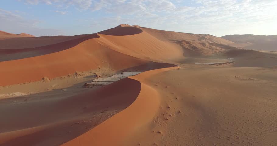4K aerial view of endless sand dunes of the Namib desert inside the Namib-Naukluft National Park   Shutterstock HD Video #17560132