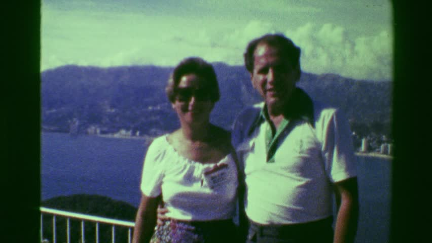 ACAPULCO, MEXICO 1978: Happy tourists posing above Acapulco bay at lookout mountain.