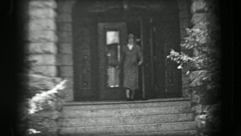 SARATOGA SPRINGS, NY 1938: Woman leaving wealthy mansion style stone brick home staircase.