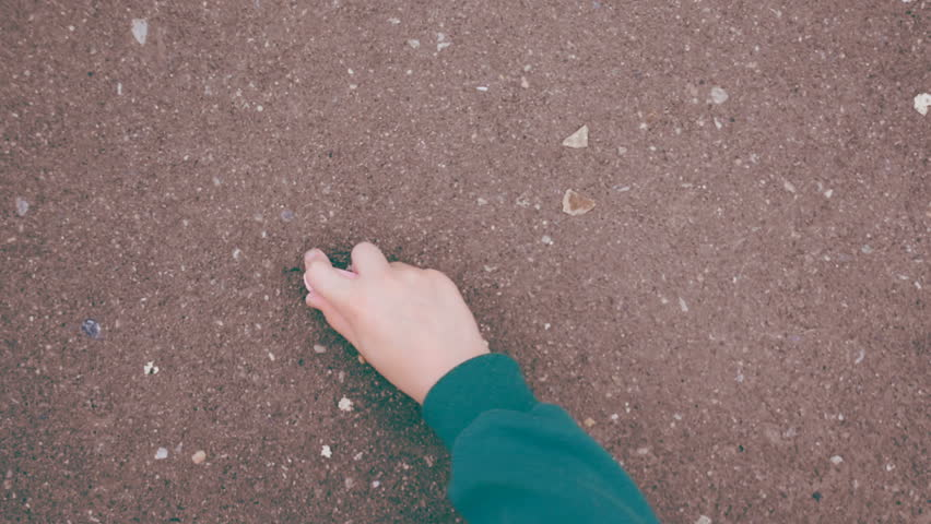 Love. The child draws a heart in chalk on asphalt. Child draw a heart. Childrens hand with pink chalk draws the heart. Trendy colored video. With place for your text.