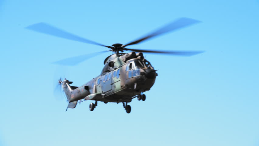 MADRID, SPAIN - JUNE 23, 2016: A Spanish Army Chinook helicopter flying over and ready to land on open field (part of 50th anniversary of the unit). Right side view. With ambient sound. ProRes HQ