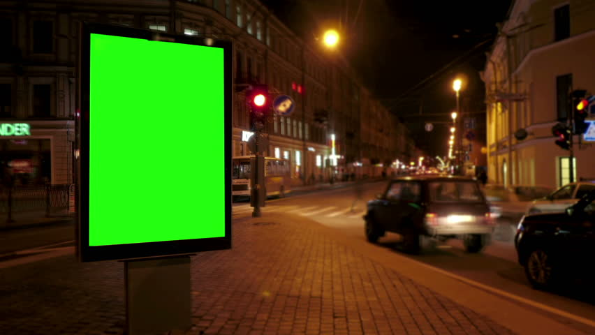 A Billboard with a Green Screen on a Busy Night Street.Time Lapse.   Shutterstock HD Video #17630917
